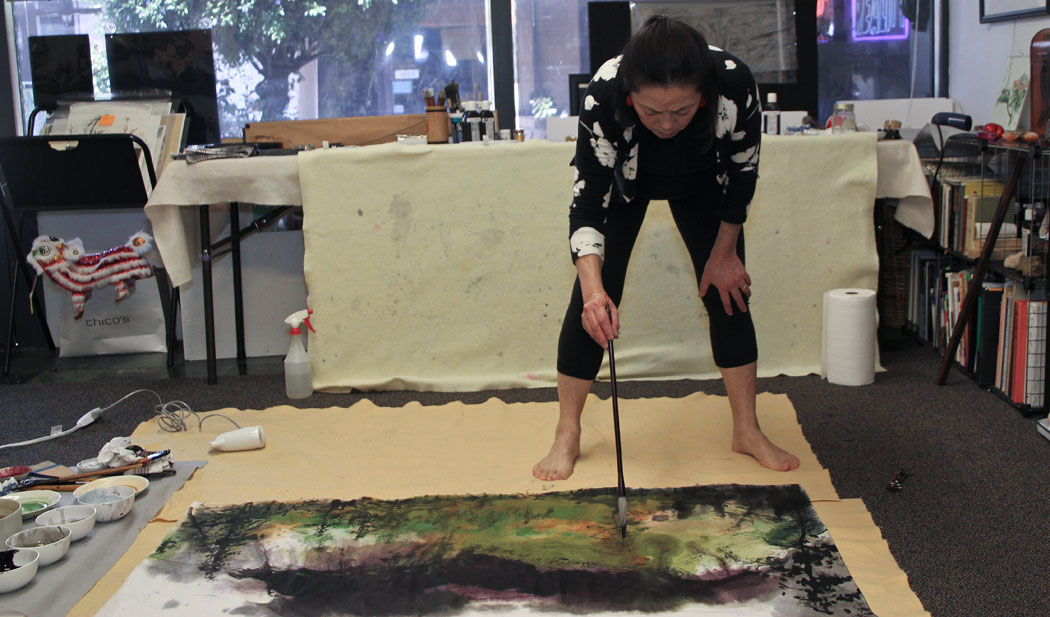 Amy Da-Peng King working in her studio