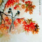 Autumn Maple leaves with two birds sitting on the branch.
