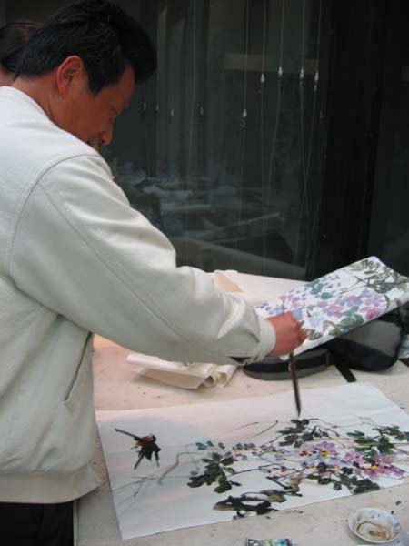 Mr. Gou  Zhen Yen, painting instructor for  flora and fauna at the academy.