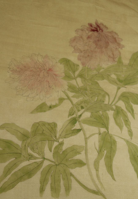 Peony flowers in the early phase of a linear style Chinese brush painting on silk.