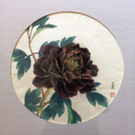 Dark red peony blossom with branch and flower